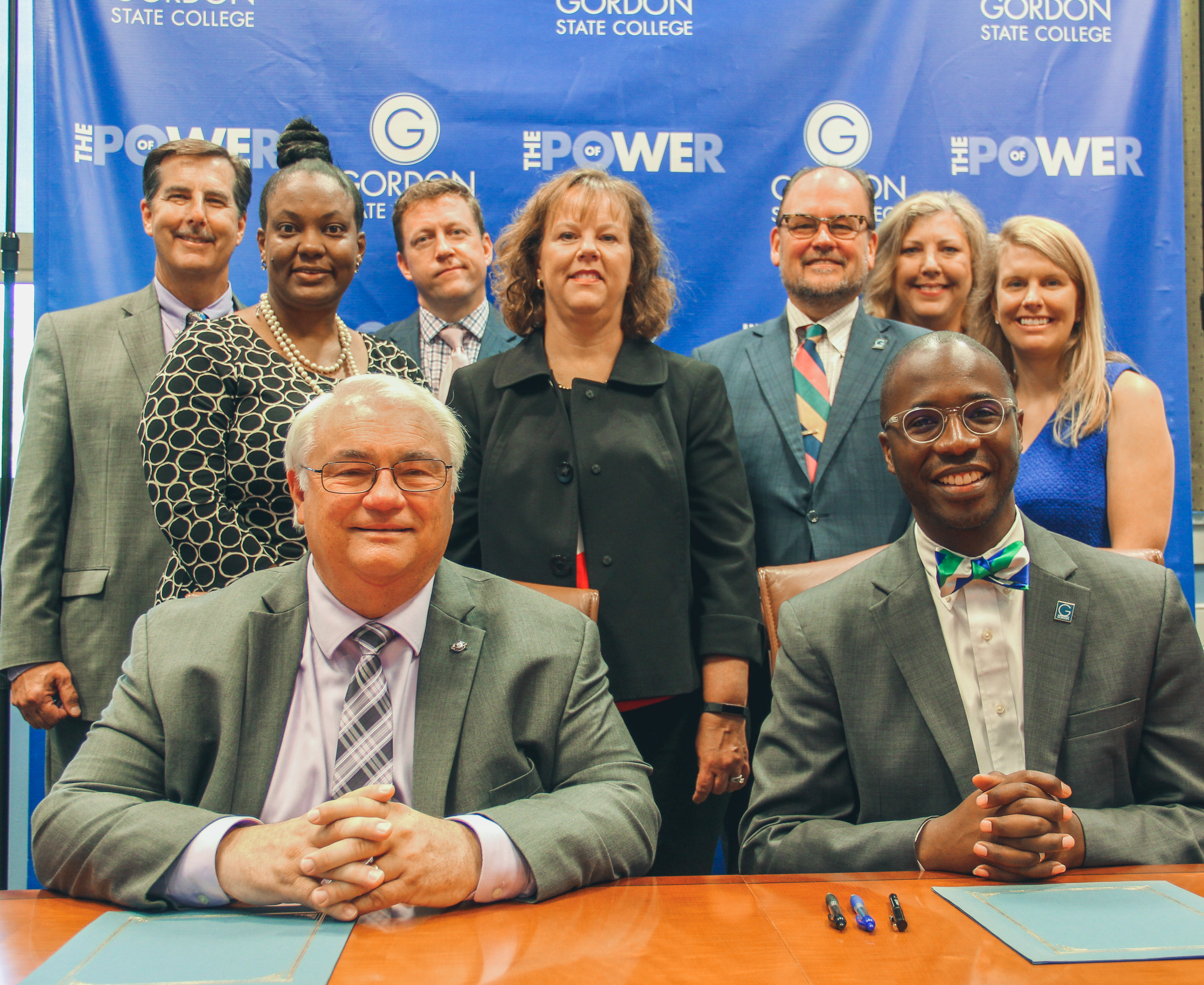 From front left, Griffin-Spalding County School System Superintendent Jim Smith joins Gordon State College President Dr. Kirk A. Nooks after signing the articulation agreement. Back row from left, Dr. Ric Calhoun, GSC Assistant Vice President for Innovative Education and Strategic Initiatives; Dr. Tiffany Taylor, GSCS Director of Strategic Talent Management; Dr. Joseph Jones, GSC Dean for School of Education; Stephanie Dobbins, GSCS Executive Director for Human Resources; Dr. C. Jeffrey Knighton, GSC Provost and Vice President for Academic Affairs; Dr. Julie Little, GSC Assistant Professor and Dr. Katie Wester-Neal, GSC Assistant Professor and PDS Program Director.