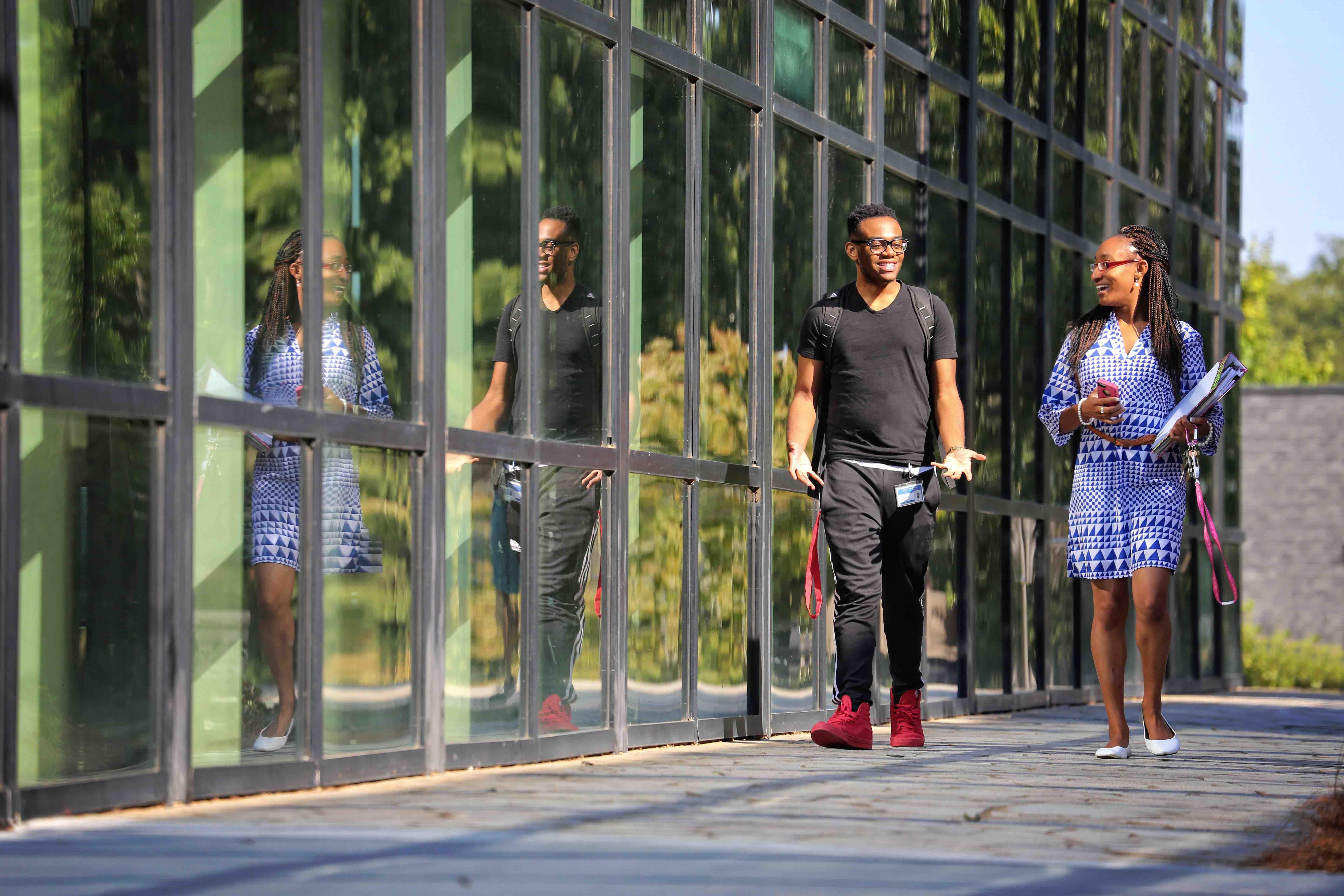 students-walking-glass-building.jpg