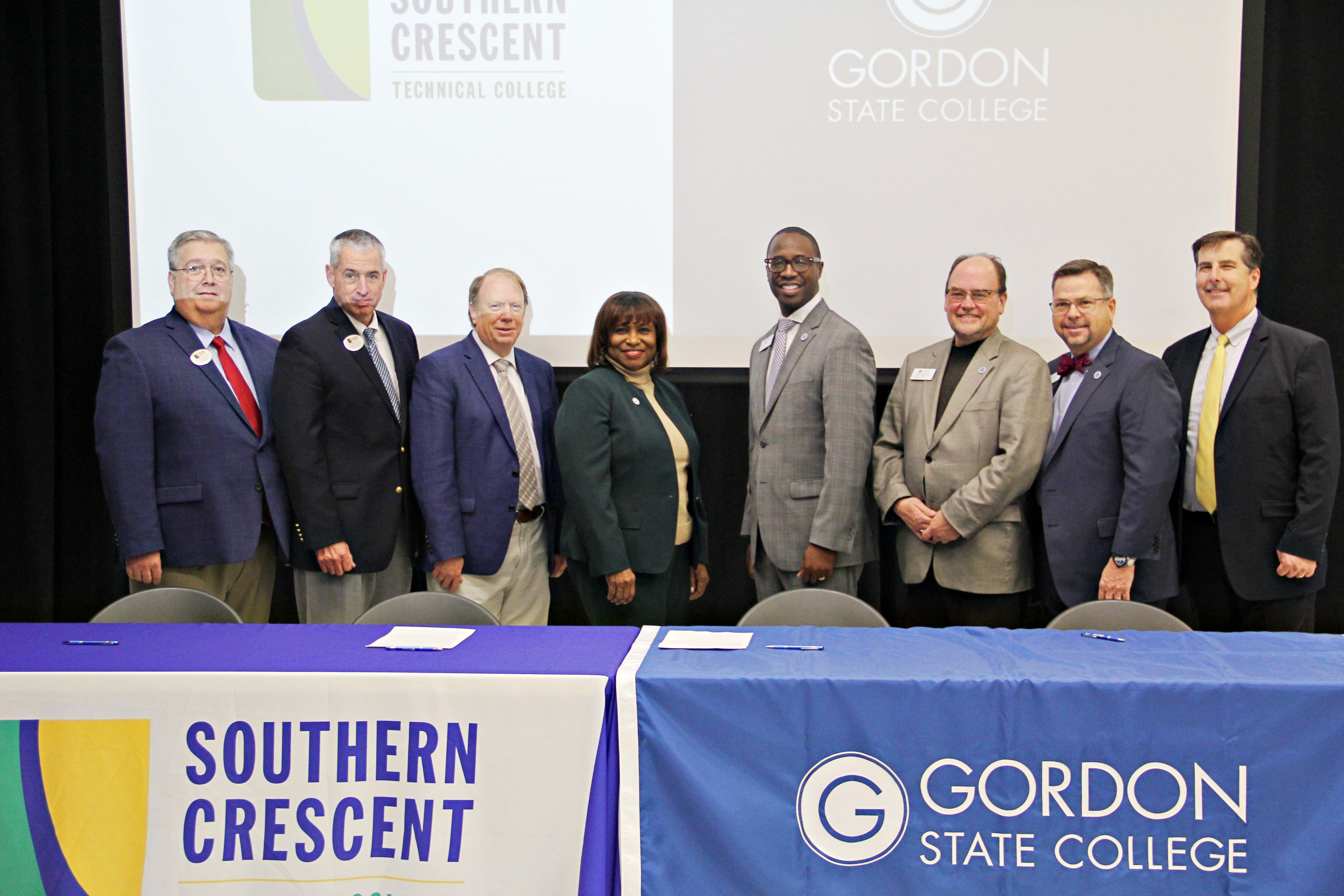 From left, representing Southern Crescent Technical College, Dr. Chris Daniel, Vice President for Institutional Advancement; Dr. Mark Andrews, Executive Vice President; Dr. Steve Pearce, Vice President for Academic Affairs; Dr. Alvetta P. Thomas, President, representing Gordon State College, Dr. Kirk A. Nooks, GSC President; Dr. C. Jeffery Knighton, Provost & Vice President for Academic Affairs; Dr. John Head, Vice President for Enrollment Management and Student Affairs and Dr. Ric Calhoun, Assistant Vice President of Innovative Education and Strategic Initiatives.